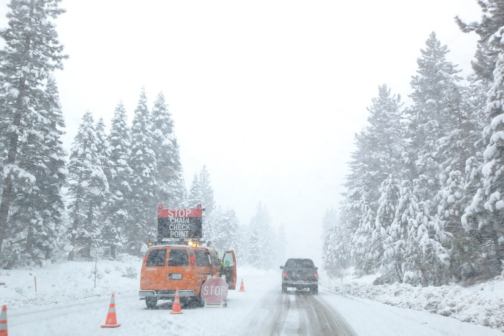 Chain check points and white-outs. Two things you learn to deal with while living in or visiting Tahoe's snowy mountains in the winter months. Photo by Sasha Coben