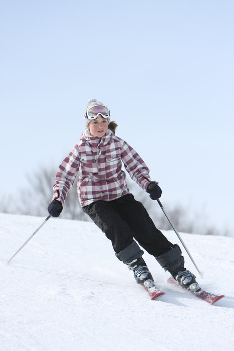 A skier makes a turn at Boyne Mountain Resort, Michigan