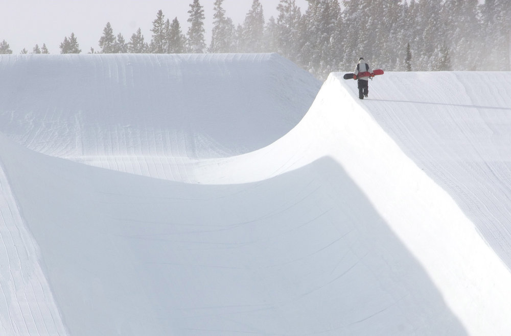 A snowboarder makes his way up the Freeeway Superpipe in Breckenridge, Colorado