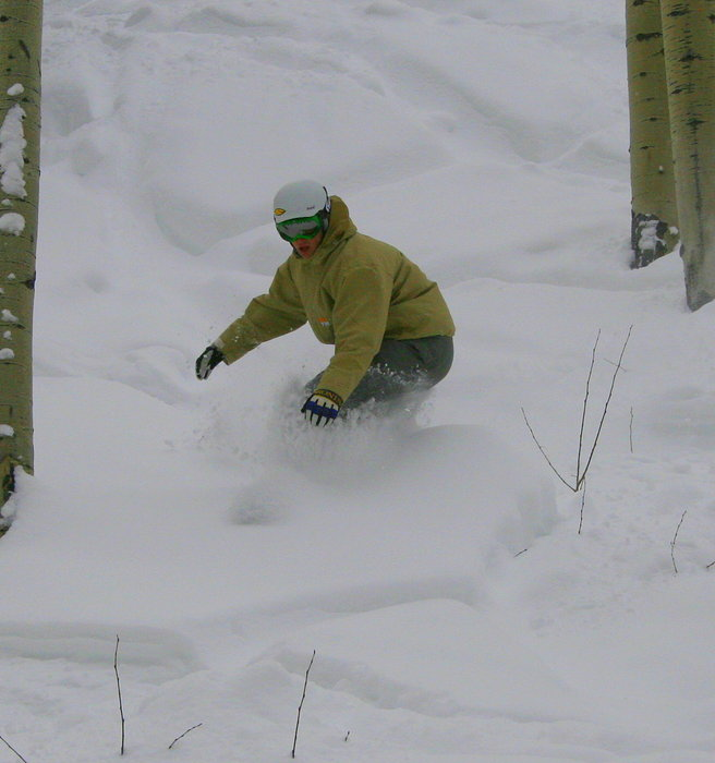 A snowboarder finds powder at Big Powderhorn Mountain, Michigan
