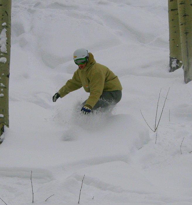A snowboarder finds powder at Big Powderhorn Mountain, Michigan