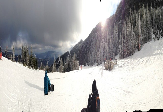 there making snow like crazy its a little icy and bare in some spots but mostly a great day to board or ski