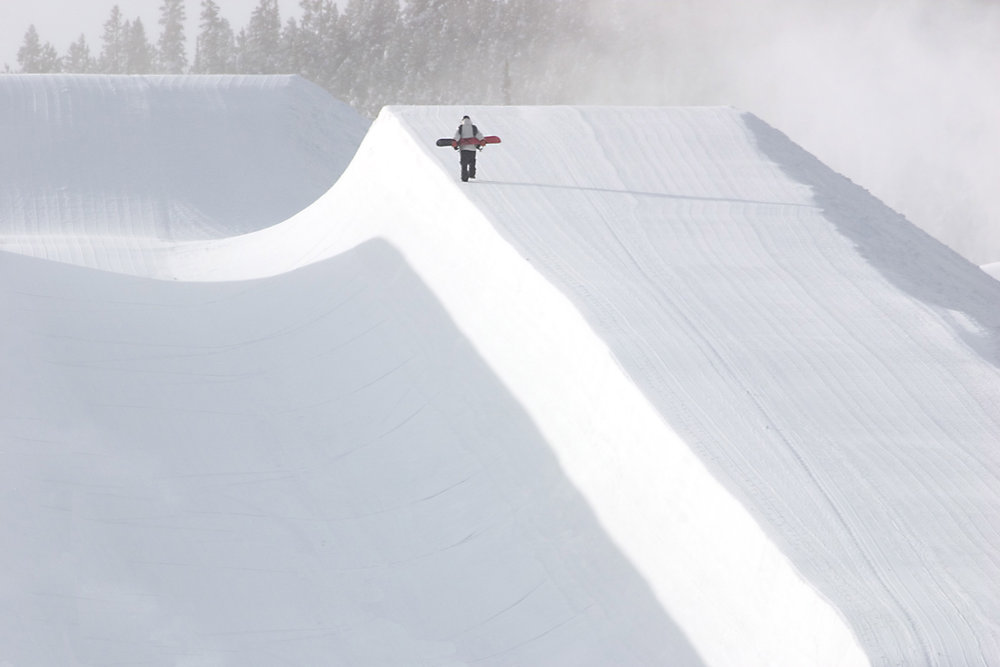 A snowboarder makes their way up the Freeway Superpipe in Breckenridge, Colorado