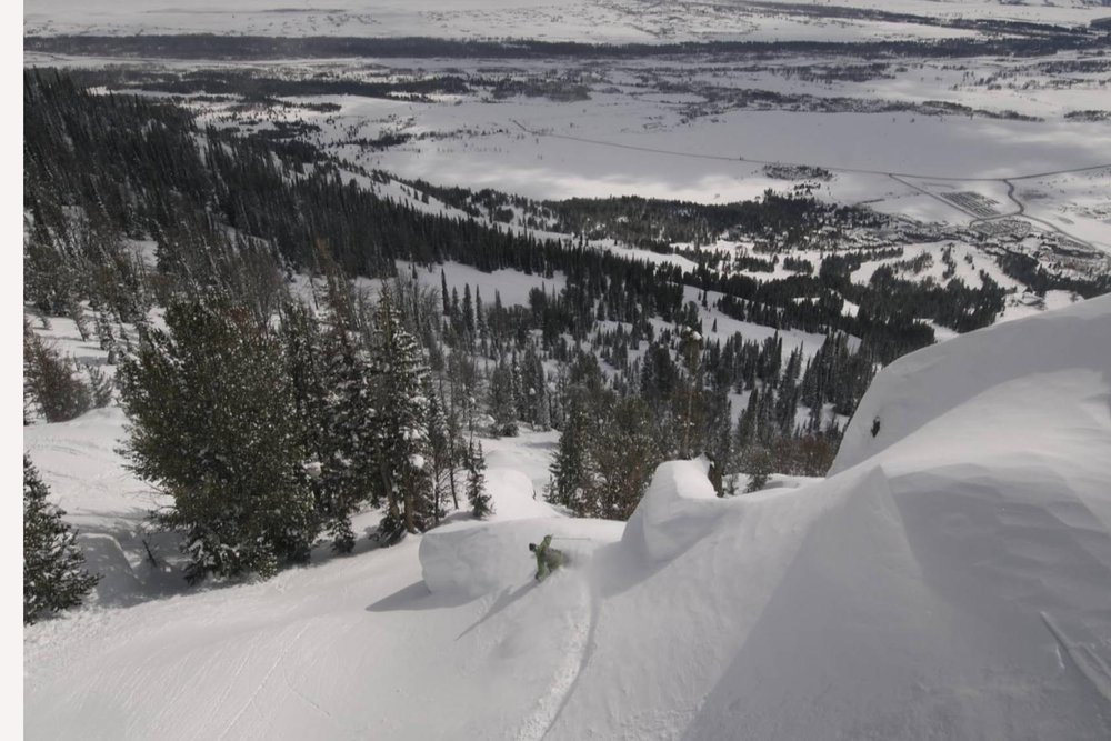 A snowboarder cruises down the mountain in the backcountry of Jackson Hole Mountain Resort, Wyoming