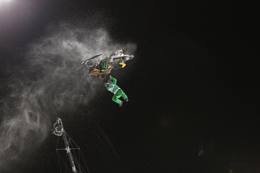 Holding on during the Snowmobile Best Trick finals. Photo by Tim Shisler