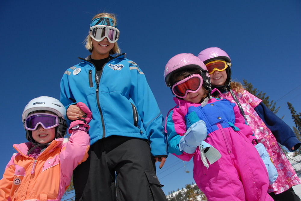 Three young skiers take lessons at Sugar Bowl Ski Resort, California