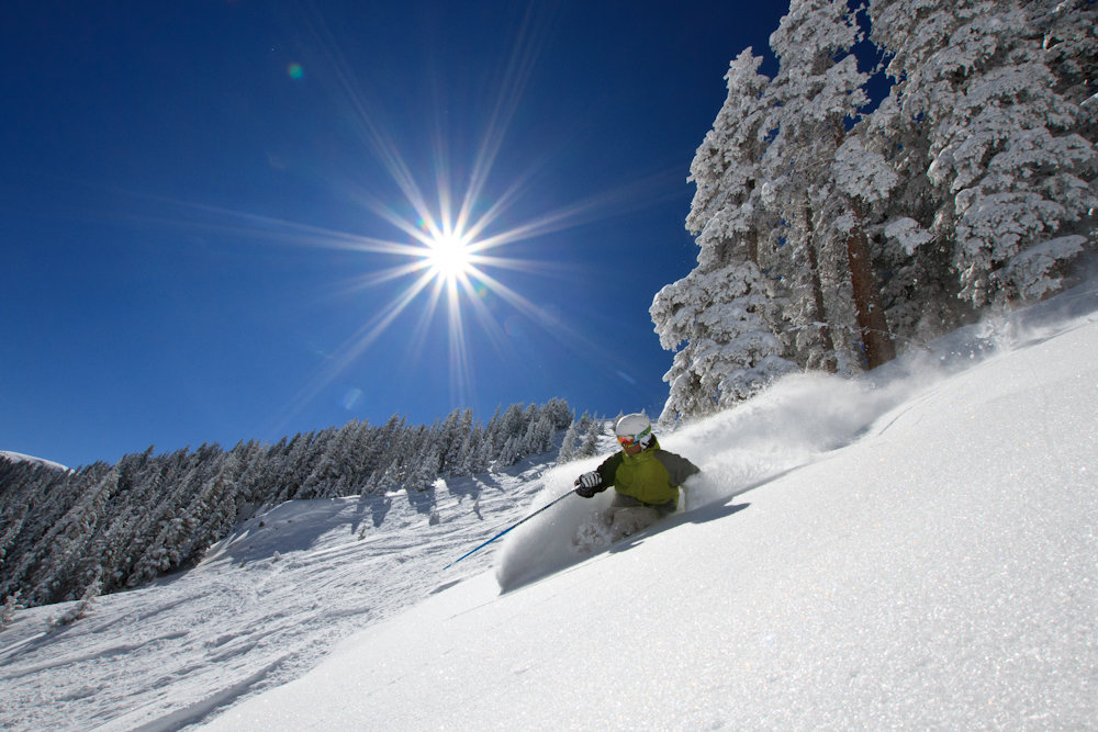 With an average of 300+ inches a year, Taos skiers and boarders get plenty of powder days. Skier Bert Flores enjoys his. Photo by Liam Doran