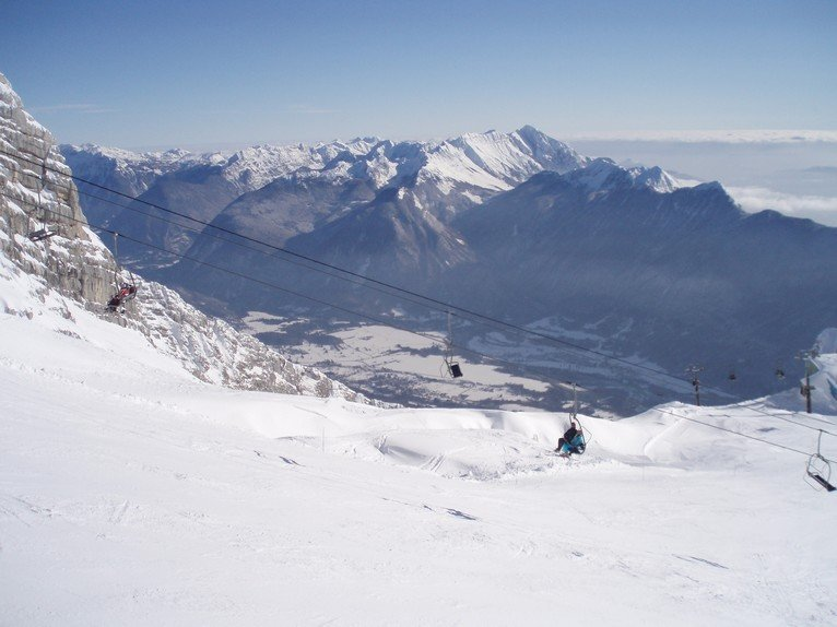 Looking down over the old 'Iron Curtain' divide when skiing from Kanin to Sella Nevea