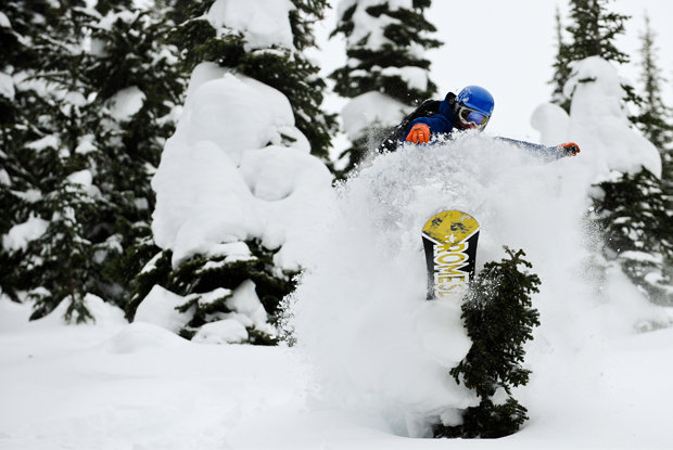 A snowboarder takes advantage of a tree pillow.  - ©Dan Stewart