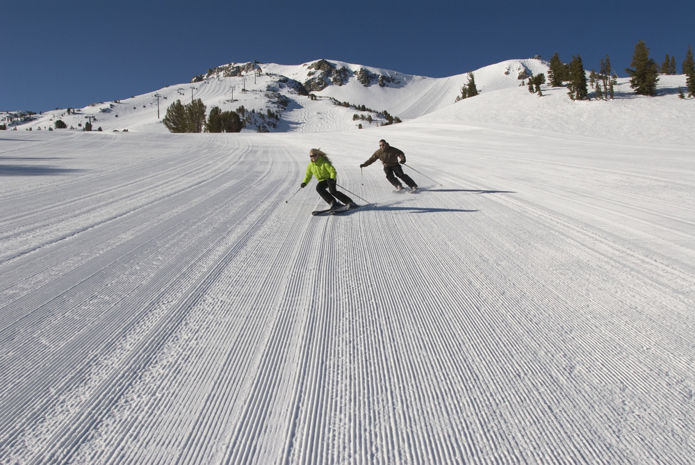 Two skiers find groomed snow on a run in Mammoth Mountain, California