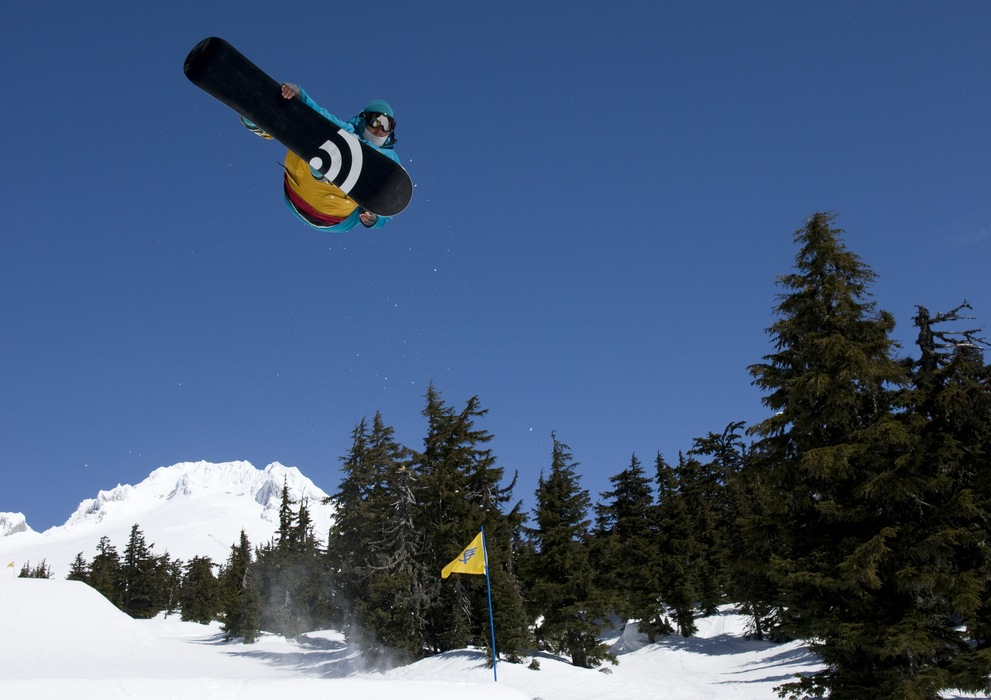 A snowboarder grabs air at Timberline Lodge. Photo courtesy of Timberline Lodge.
