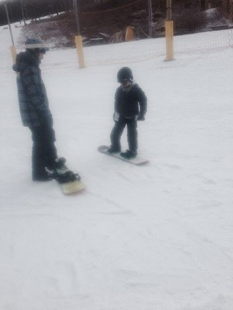 First day on the board.. Proud daddy .thanks to James at snowboard camp.