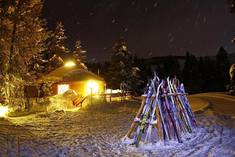 Nordic ski or snowshoe to a gourmet dinner at Crested Butte Nordic's yurt.
