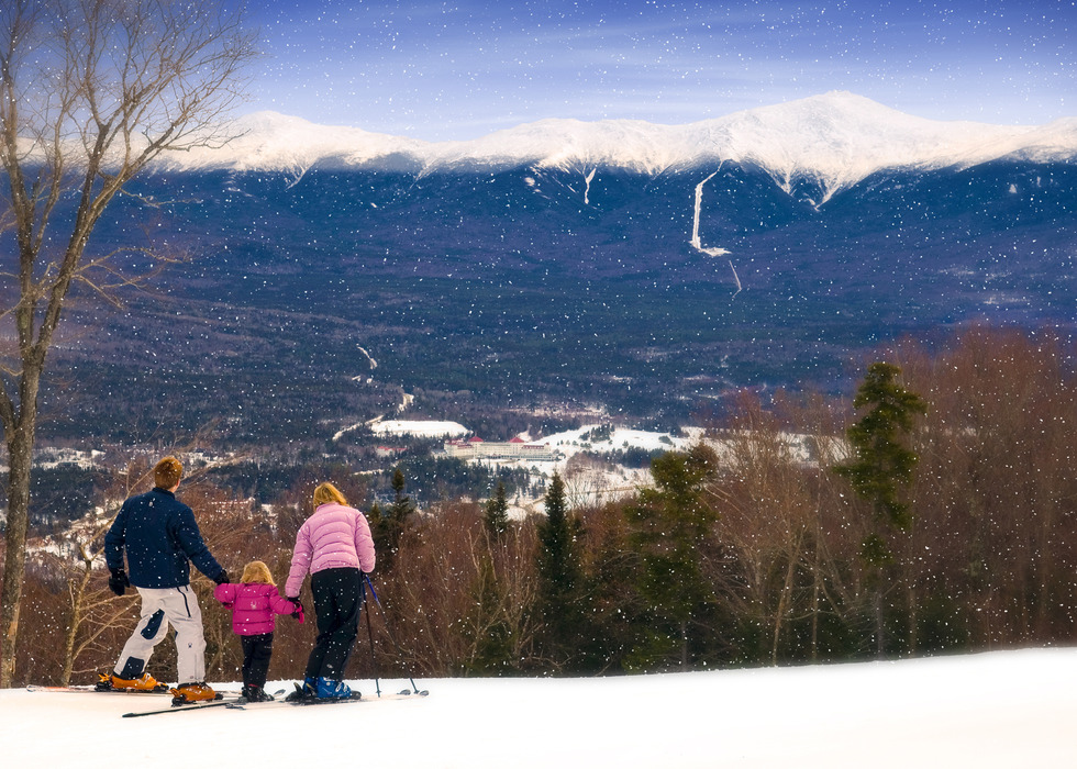 A family pausing to take a look over Bretton Woods.