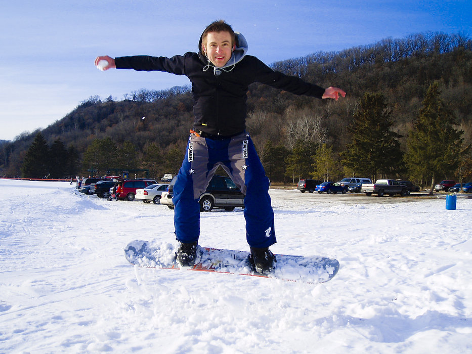A snowboarder with a snowball in his hand at Afton Alps, Minnesota