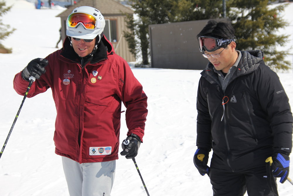 A skier takes a lesson at Michigan's Crystal Mountain