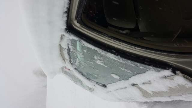 snow is wet and heavy but there sure is a lot. This was my car after sitting on top of Berthoud for 5 hours yesterday 3/7/14