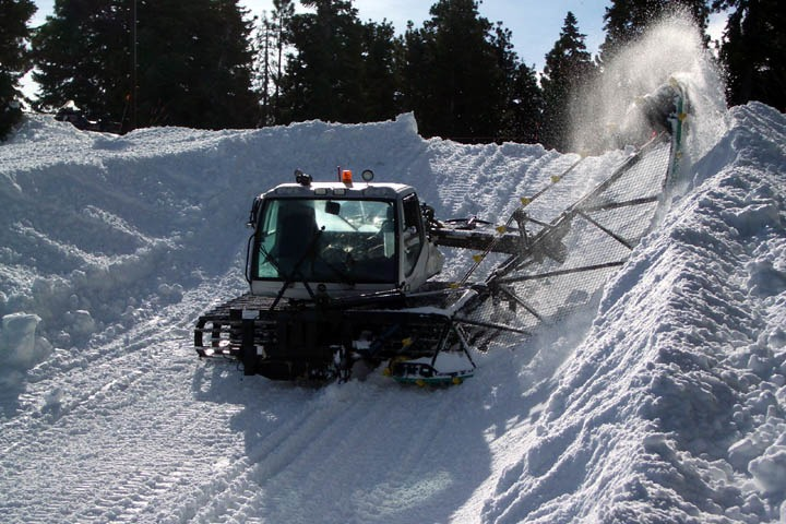 A snowcat grooms out the halfpipe at Mountain High, California