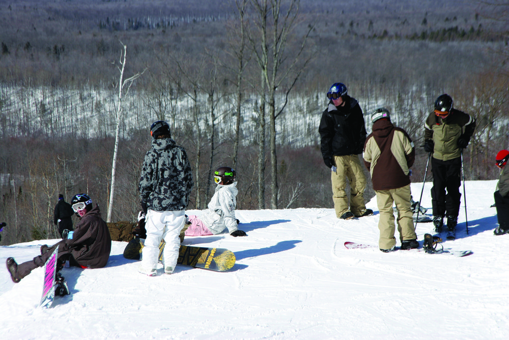 Skiers and snowboarders waiting to drop in at Indianhead. - ©Indianhead Mountain Resort