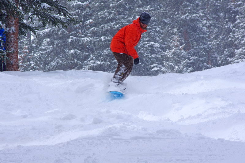 A snowboarder hits the powder at Arapahoe Basin.