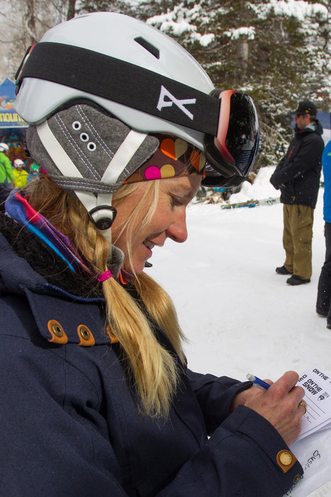 Diligent ski testers cranking through cards.