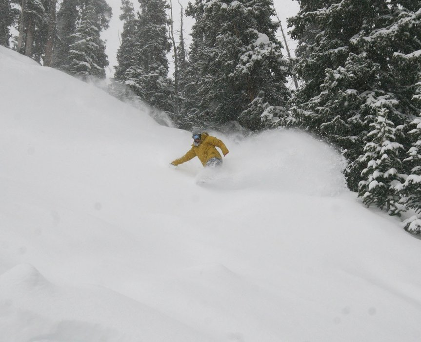 A snowboarder in heavy powder at Copper Mtn. CO.