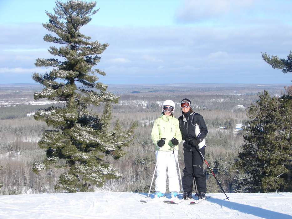 A pair of skiers pause for a photo at Pine Mtn, MI.