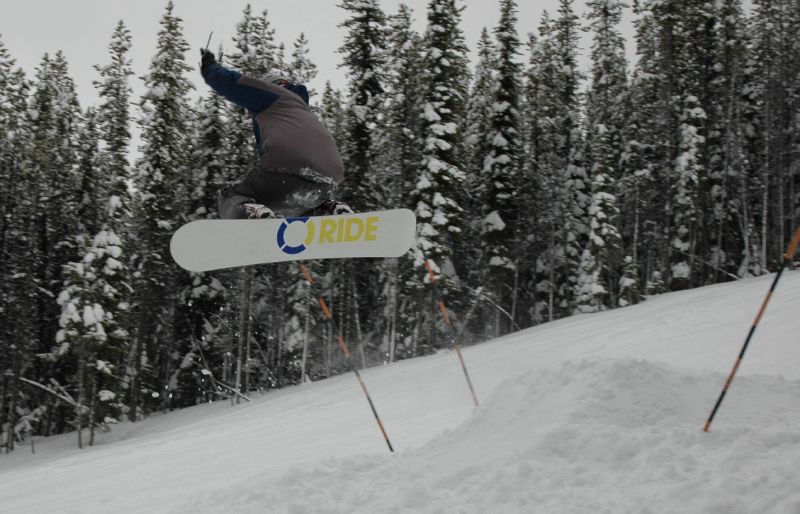 A snowboarder catching air at Blacktail Mountain, Montana.