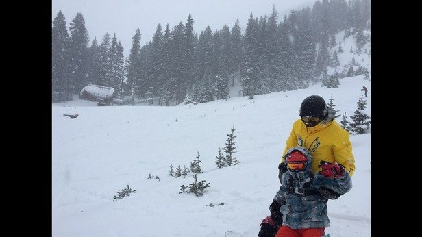Taylor with his coach. Snow falling in front of the new Kachina lift. Taos kicks @ss!!!! Over 10
