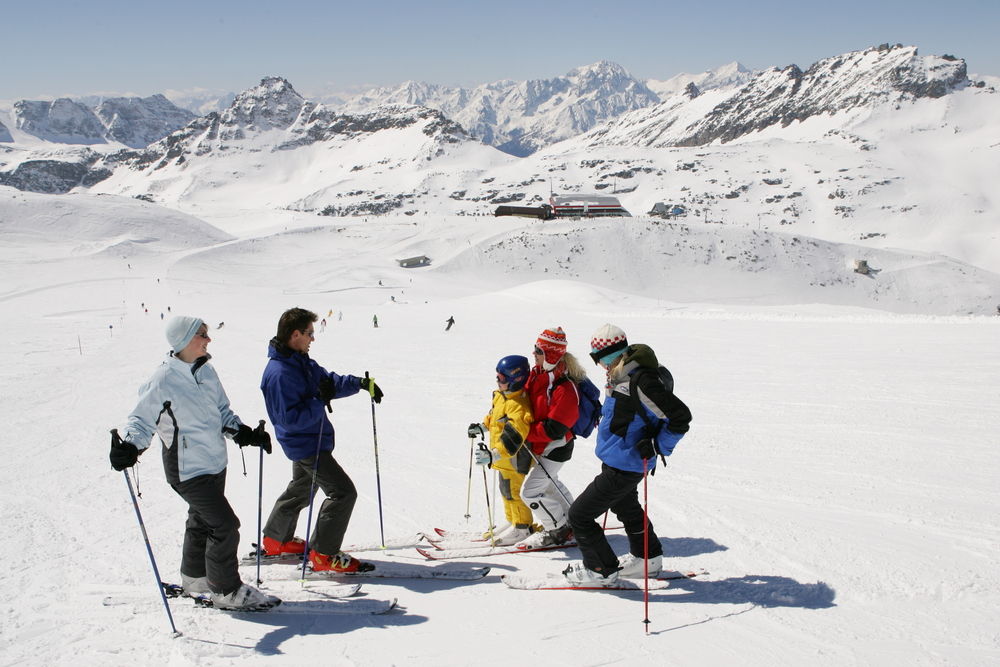 Skiers pause to chat and rest at Flattach Mölltaler AUT