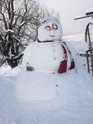 Lovely day for a snowman. Snowing none stop all today. Awesome!