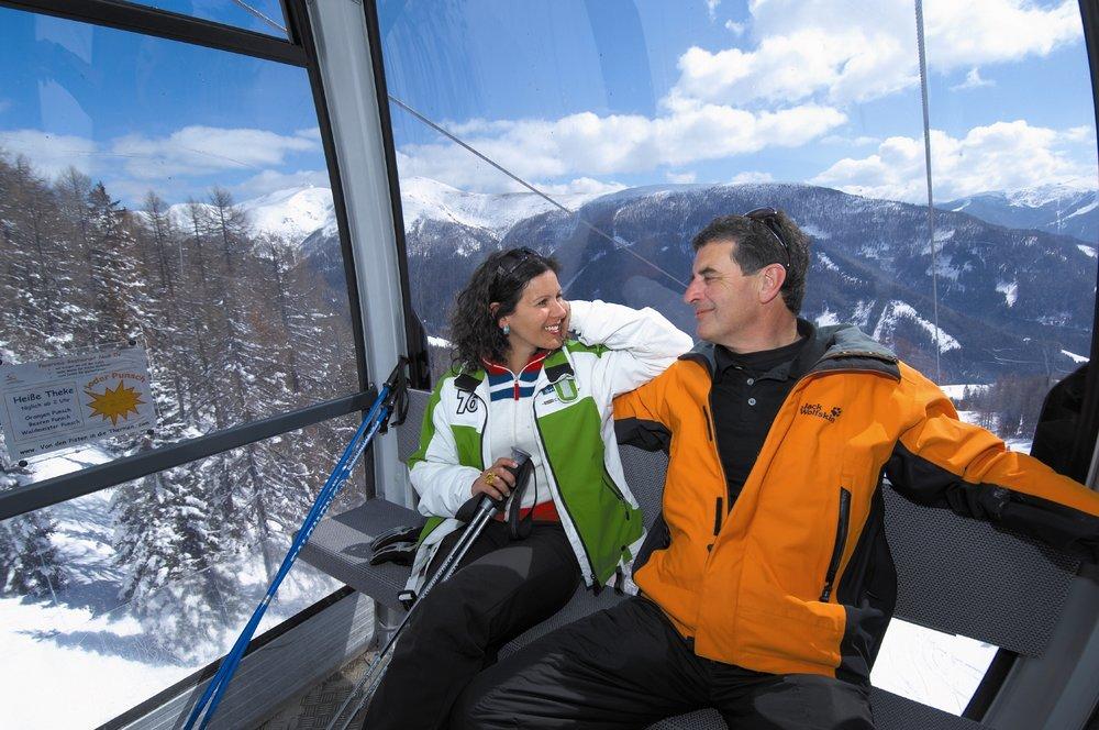 Ski couple in gondola, Bad Kleinkirchheim, Austria
