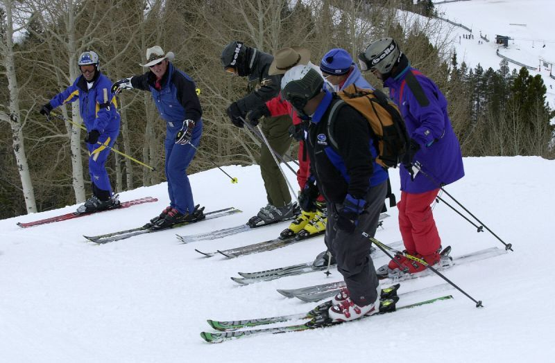 Instructors teach a group of kids how to ski in Steamboat, Colorado