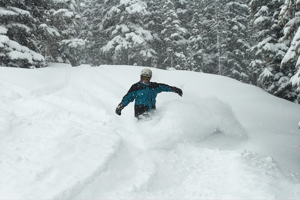 A snowboarder in deep powder at Aspen.