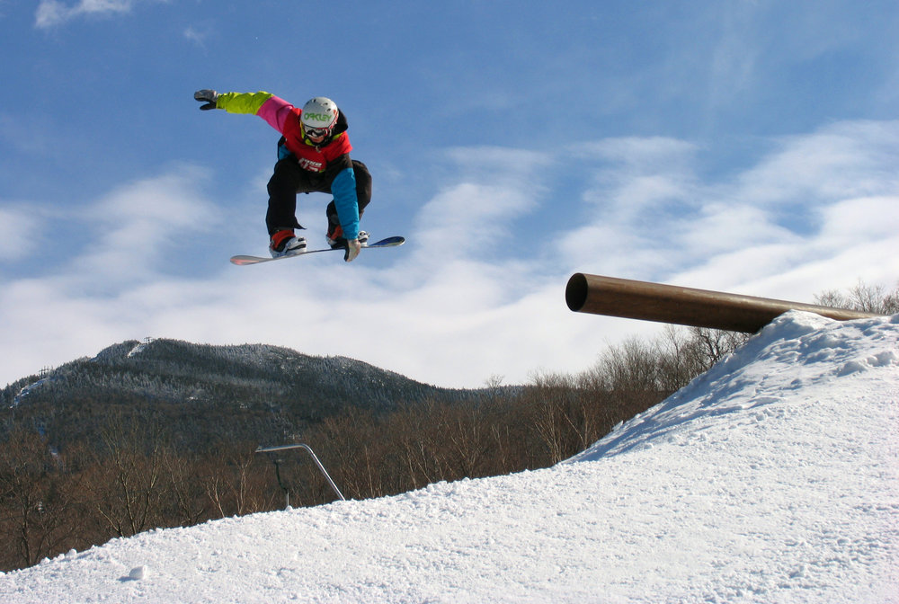 A snowboarder takes to the air at Smugglers' Notch, Vermont.