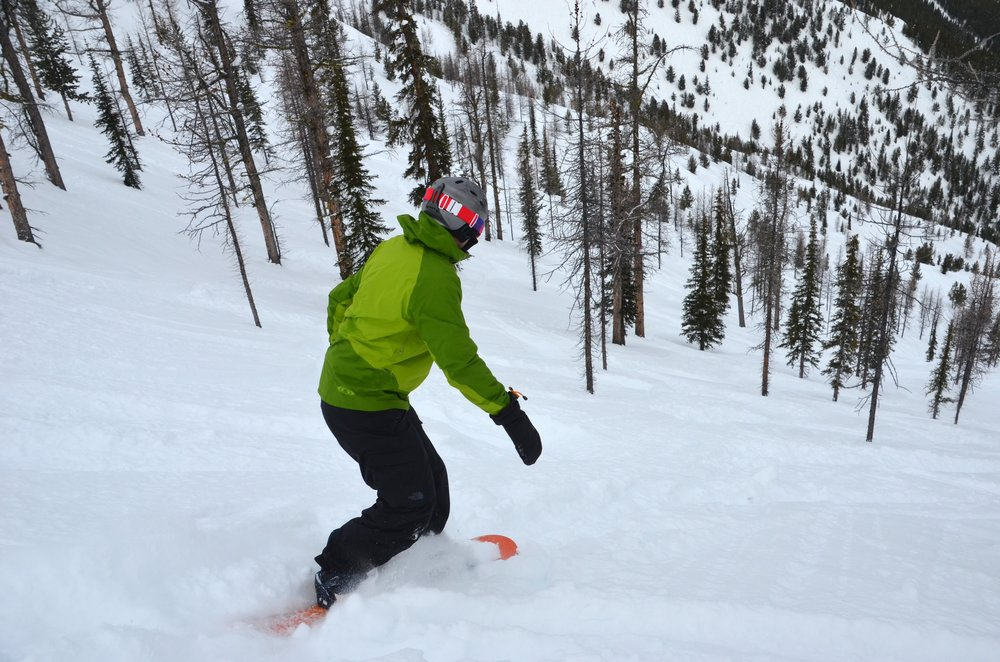 A snowboarder descends into the new gladed areas of Taynton Bowl at Panorama. - ©Panorama Mountain Resort