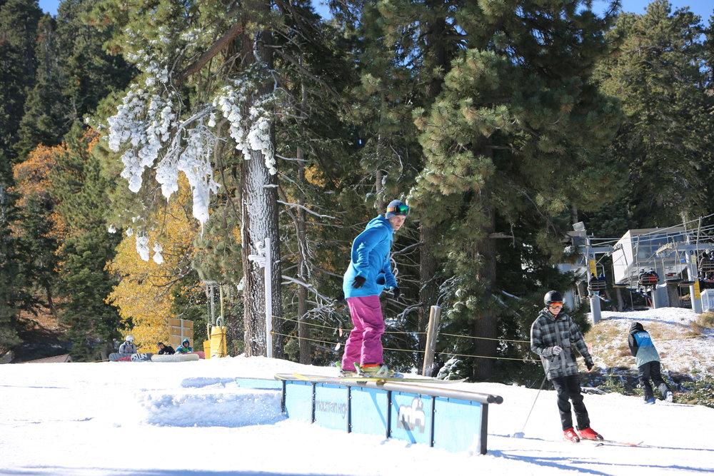 A skier hops on a rail at Mountain High. - ©Mountain High