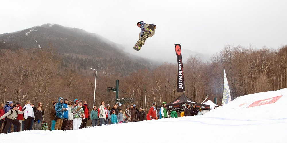 Snowboarder jumping at Smugglers' Notch, Vermont.