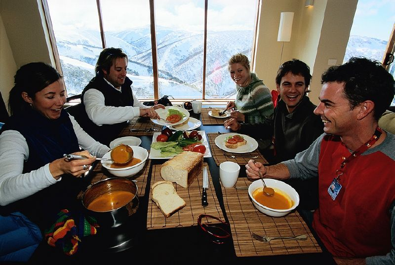 Group of people dining on the mountain