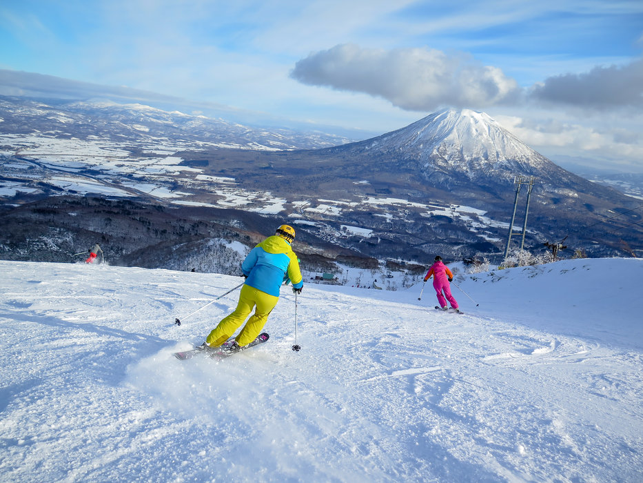 Skiing long cruisers at Niseko Village Resort. - ©Linda Guerrette