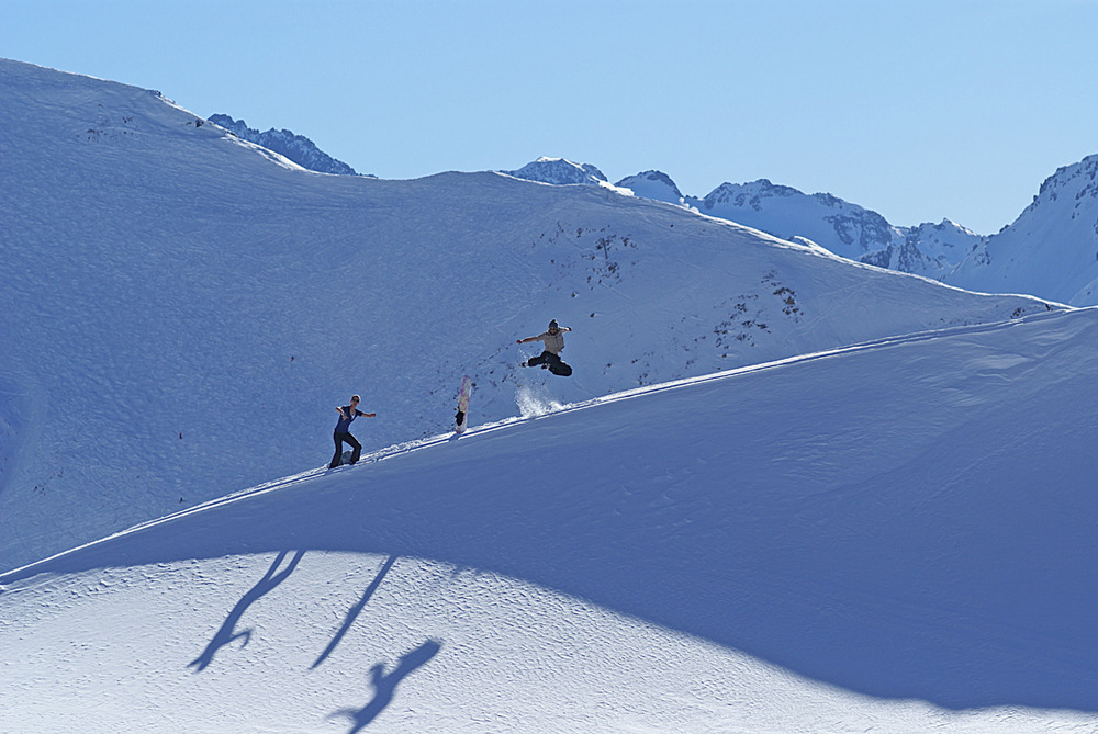 Snowboarders playing around at Ischgl, AUT.
