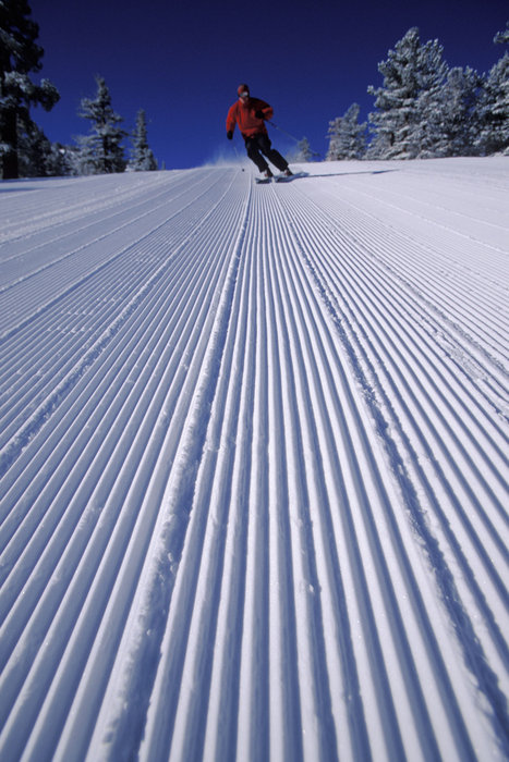 A skier enjoying a freshly groomed run at Heavenly CA