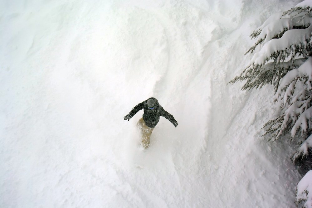 Kirkwood snowboarder charging through the fresh. - ©Kirkwood