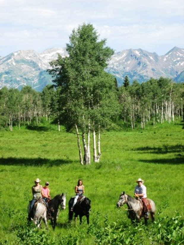 Utah's Rocky Mountains provide a beautiful backdrop for summertime horseback riding. - ©Rocky Mountain Outfitters