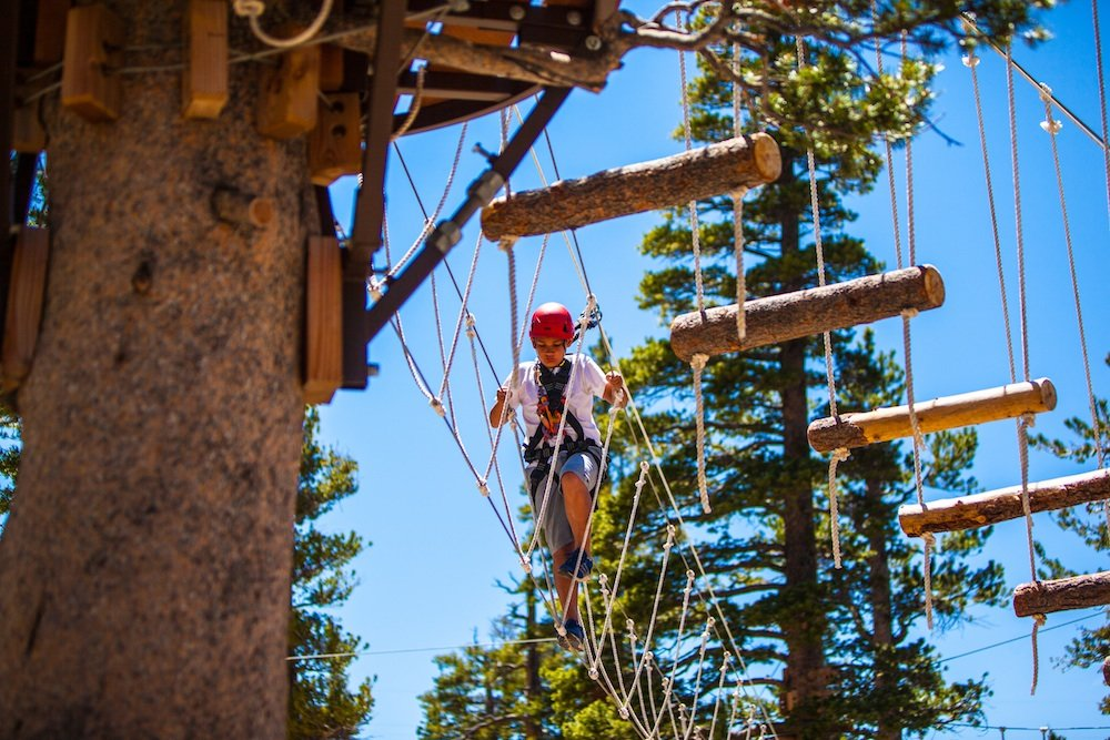 Navigating a ropes course at Heavenly. - ©Heavenly Mountain Resort