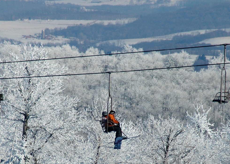 Skiers on a lift at Seven Springs PA