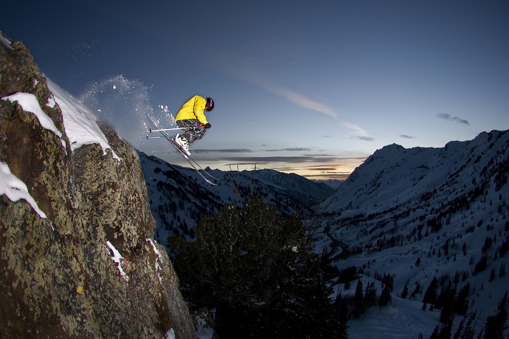 Skier leaving a cliff at Alta, UT. Photo by Salt Lake CVB/Damian Cromwell.