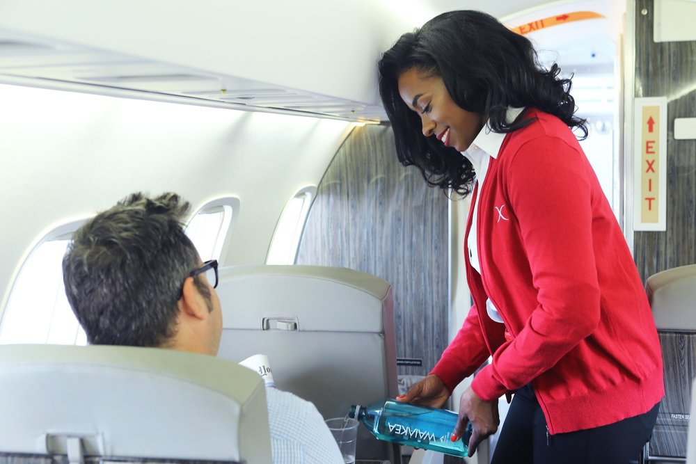 Flying public charter means free checked bags, inflight WiFi and entertainment, drinks and snacks, and seat assignments. - ©JetSuiteX
