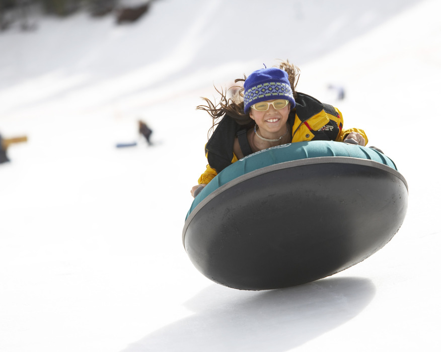 Girl tubing at Angel Fire. Photo by Jack Affleck.