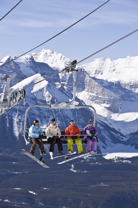People on a chairlift in Lake Louise